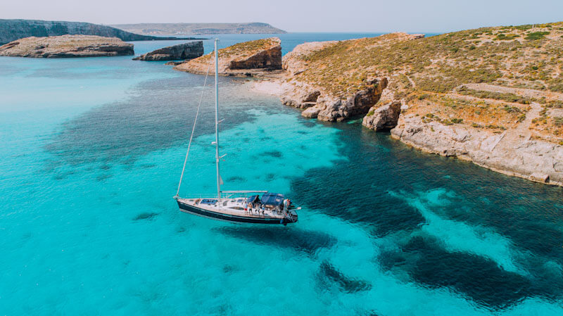 Aerial of Yacht in Blue Lagoon, off Comino_edited