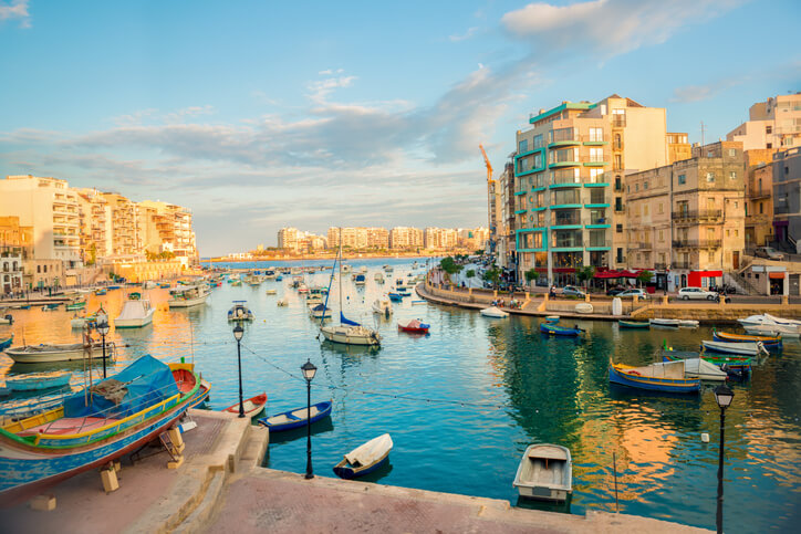 Harbor with maltese yachts and boats in St. Julians to Sliema, Spinola Bay, Malta